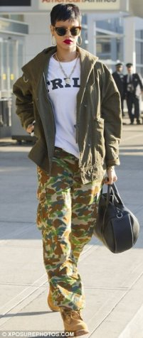 Army chick: Rihanna was wearing camouflage trousers, a khaki jacket and combat boots when she touched down in New York earlier in the day