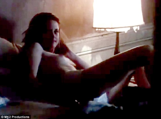 In the buff: Kristen Stewart is seen laying completely naked on a bed in a new film still for her upcoming movie On The Road