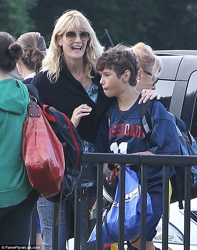 Sporting prowess: Laura Dern looked delighted as her son Ellery prepared to take to the pitch at the soccer game in California on Wednesday