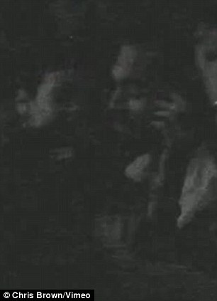 Cuddling up: The video shows footage of Rihanna and Chris inside the nightclub