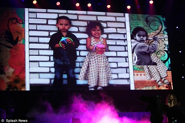 A family affair: Photographs of J-Los children, four-year-old twins Max and Emme, were projected on screens