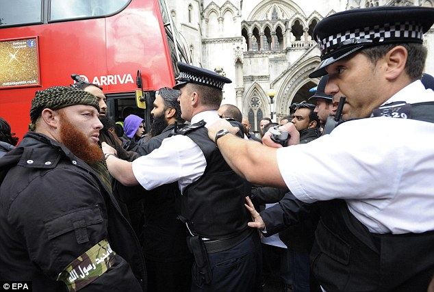 Clashes: Demonstrators scuffle with police outside The Royal Courts of Justice in London as radical Islamic cleric Abu Hamza al-Masri and four other terror suspects lose their battle to stay in the UK