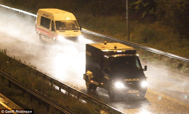 The convoy of terror suspects in armoured police vans on their way to the American air base in the dark last night