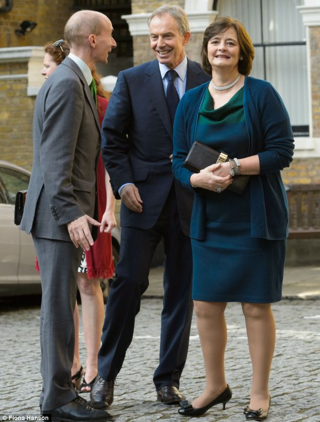 Former Prime Minister Tony Blair and his wife Cherie in a knee-length dress and black kitten heels