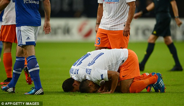 Prayer position: Montpellier's French midfielder Karim Ait-Fana and Montpellier's Moroccan midfielder Younes Belhanda (right) celebrate by assuming prayer position
