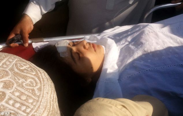 Recovering: A 'stable' Malala Yousafzai, is moved to a helicopter to be taken to Peshawar for treatment today