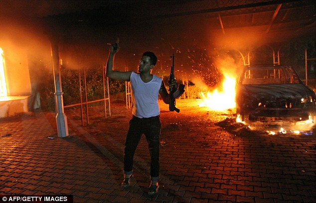 Rage: A protester holding his rifle during the assault on the U.S. Consulate in Benghazi on September 11th