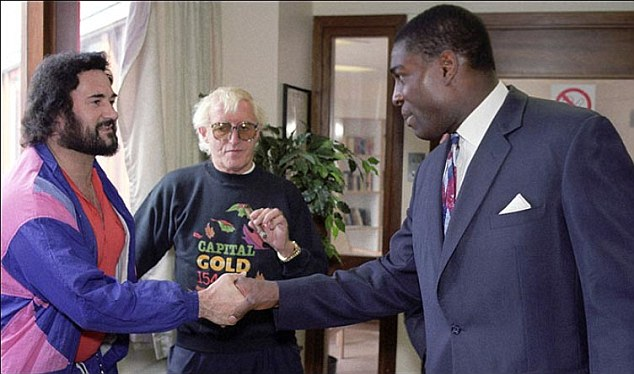 Savile, seen at Broadmoor in 1991, as Yorkshire Ripper Peter Sutcliffe meets boxer Frank Bruno, who was on a visit to open a new gym