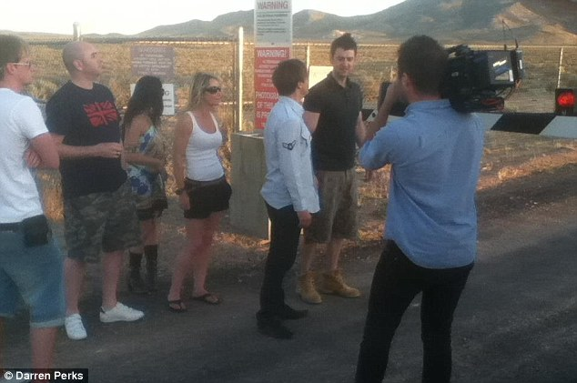 Getting ready to cross: The team of 12 hesitate at the gates - and the decide to cross over