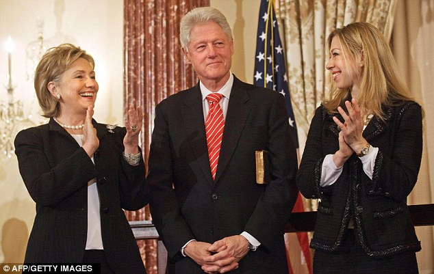 US Secretary of State Hillary Clinton and Chelsea applaud as Vice President Joe Biden introduces former president Bill Clinton at a ceremonial swearing-in at the State Department in Washington in 2009
