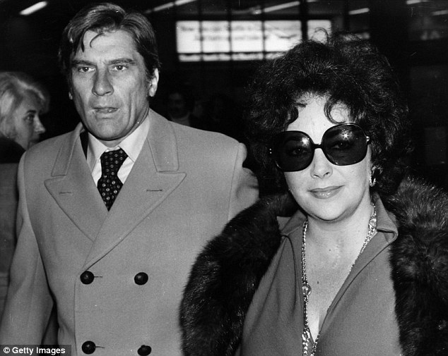 Under cover: Taylor arrives at Heathrow Airport with her seventh husband John Warner in December 1976