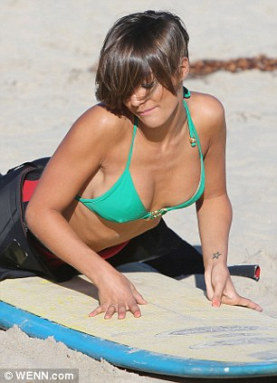 Helping hand: Frankie displayed her new curves more obviously as she took part in the surfing lesson
