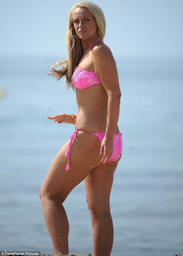 Pretty in pink: Josie highlighted her tan in the bright pink two piece as she soaked up the sun