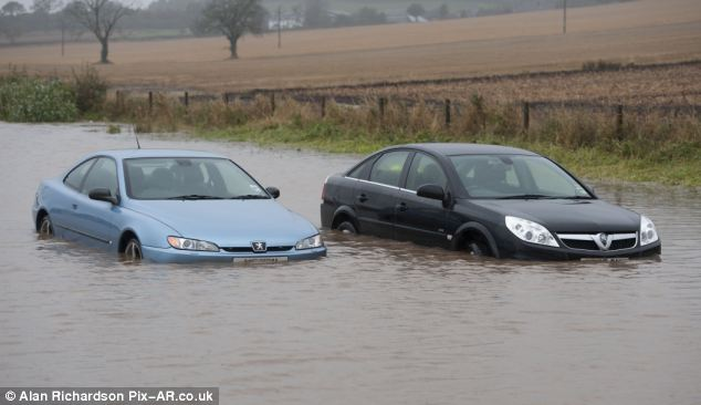 Abandoned: Motorists stuck int he flood waters were forced to abandon their cars on the A92 between Dundee and Arbroath yesterday