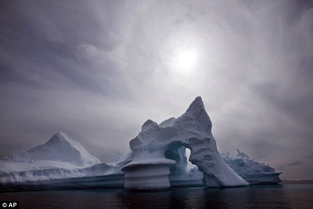 Research: The new figures mean that the ¿pause¿ in global warming has now lasted for about the same time as the previous period when temperatures rose, 1980 to 1996. This picture shows an iceberg melting in Eastern Greenland