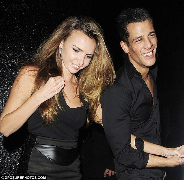 Lovebirds: The new couple held hands as they made their way out of the club and into a taxi