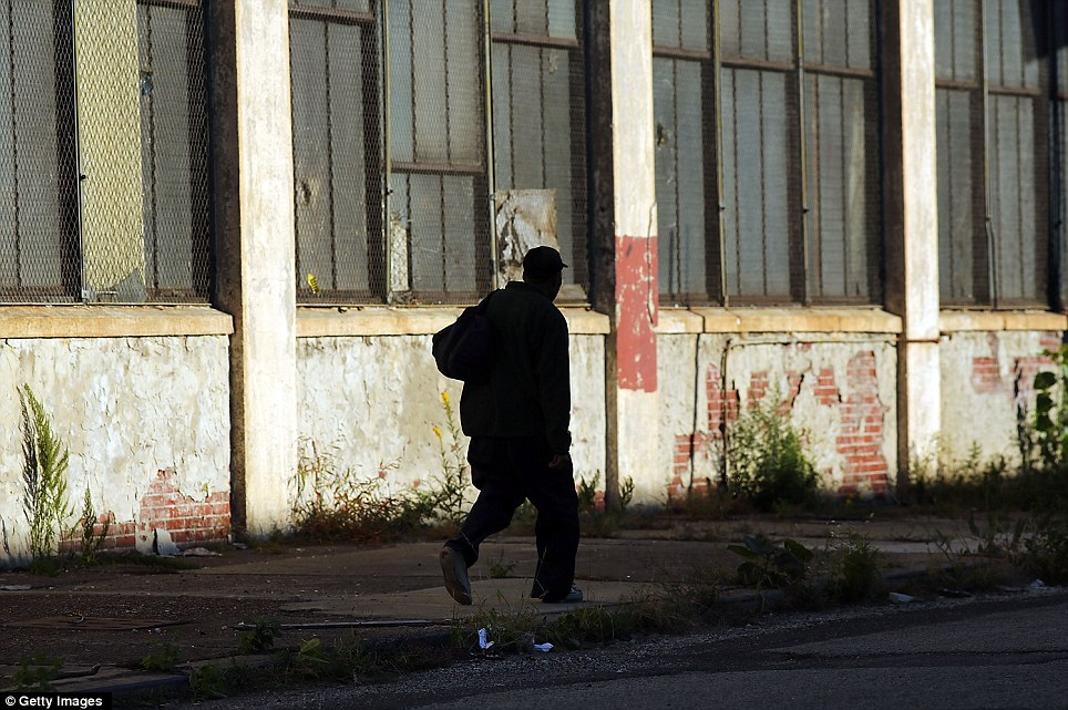 A man walks by a deserted factory in Camden where almost 20 per cent of residents are out of work