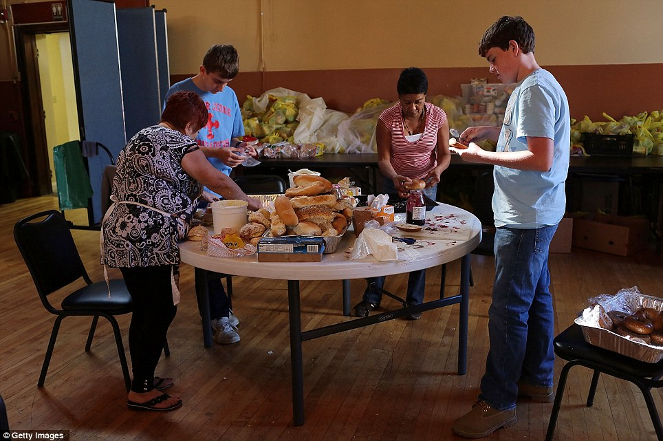 Volunteers prepare sandwiches for the needy and hungry at Cathedral Hall