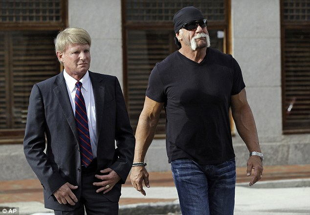Legal fight: Former wrestler Hulk Hogan (pictured today with his lawyer in Florida) is suing his best friend Bubba Clem and his wife Heather along with website Gawker for $100million over the sex tape