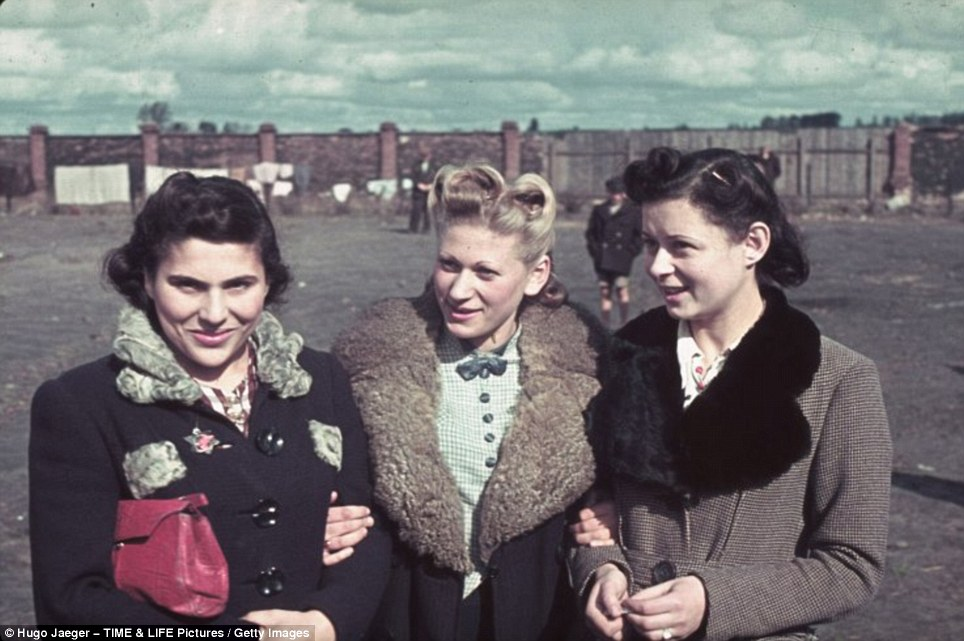 With their clean clothes and hair neatly coiffured, these three young women do not at first glance appear to be Jewish. But look closer and you find a star of David on the coat of the girl on the left