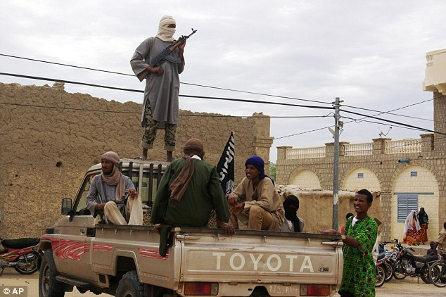 Strict: Ansar Dine, one of a number of Islamists groups who have seized control of northern Mali, allegedly lashed a girl, 15, for speaking to men in public in Timbuktu. File photo