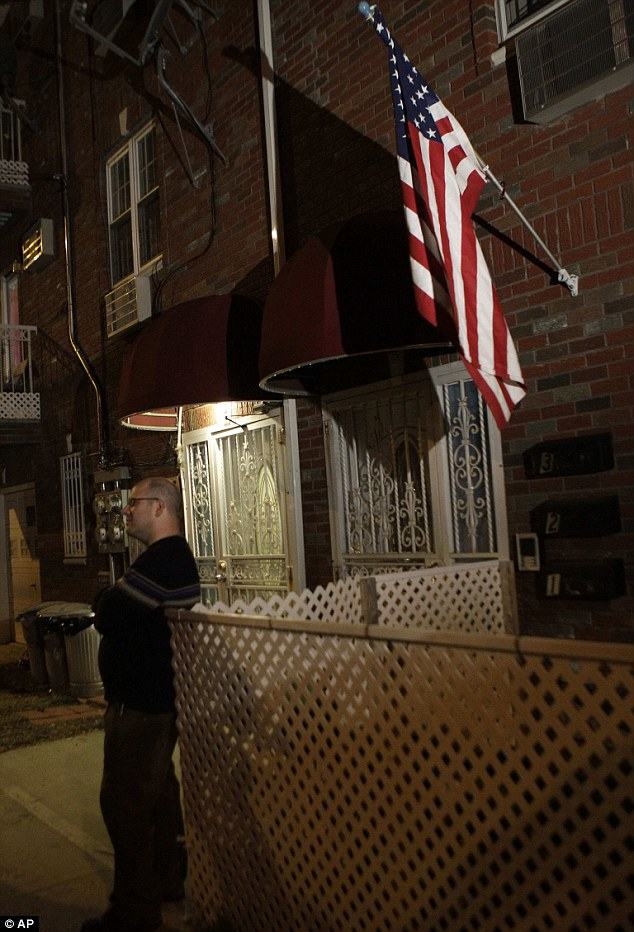 Home: A man stands outside the residence of Quazi Nafis, the alleged Federal Reserve plot suspect