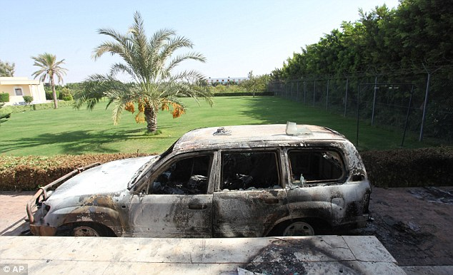 Flames, grenades and gunfire: A burnt-out car in front of the U.S. consulate