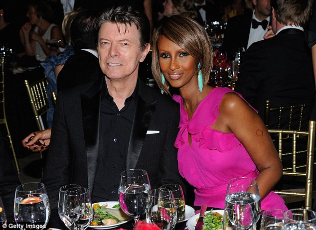 Happier than ever: Bowie, seen here at a charity gala in 2011, lives in Manhattan with wife Iman and their daughter Lexi