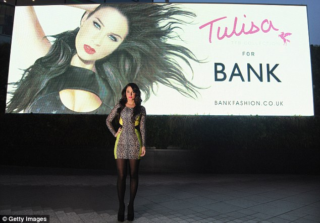 Who's that girl? Tulisa appears to have been heavily airbrushed in the Bank billboard behind the singer