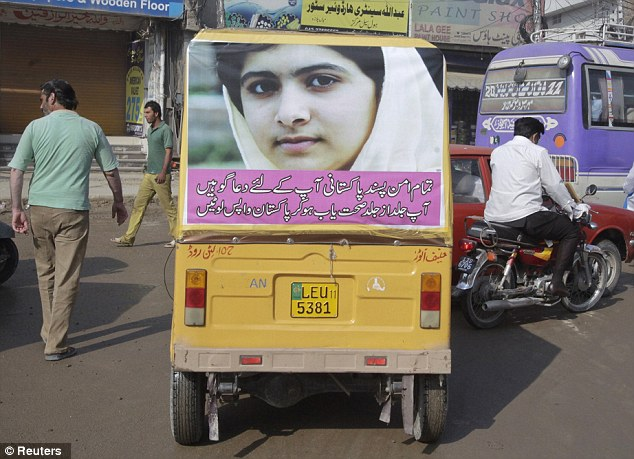 Showing support: An auto-rickshaw carrying the image the schoolgirl Malala travels on a road in Lahore