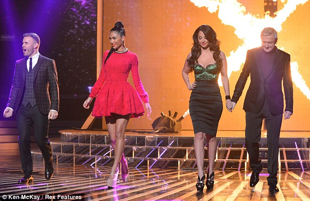 Coming out: Gary. Nicole, Tulisa and Louis stepped out onto the stage in their chose outfits as they geared up to judge the X Factor contestants