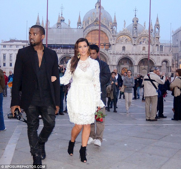 Taking in the sights: Kim and Kanye took a romantic stroll through the Italian city on Sunday evening
