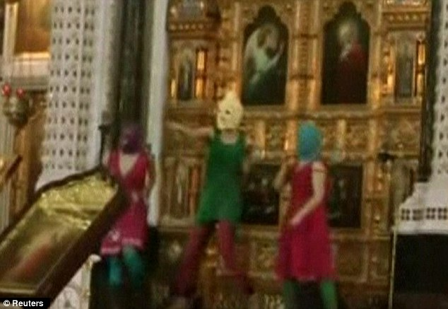 Outrage: Pussy Riot members clad in balaclavas stage their protest inside Christ The Saviour Cathedral in Moscow in February