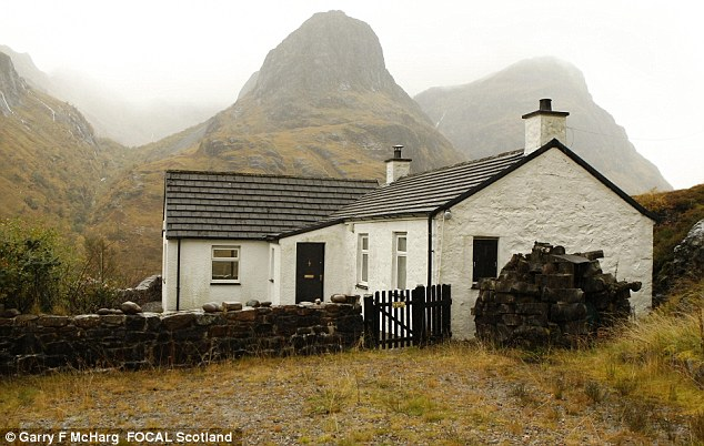 Isolated: The house with the dramatic Three Sisters mountain range in the background - Savile said he wanted to buy the cottage after spotting it on a bike ride in the 1940s