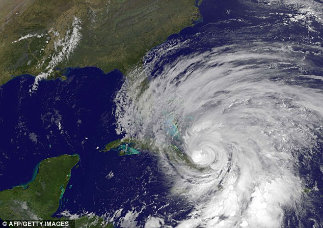 This October 25, 2012 NOAA GOES satellite image shows Hurricane Sandy. Hurricane Sandy plowed across Cuba early Thursday as a 'strong' category two storm after battering Jamaica