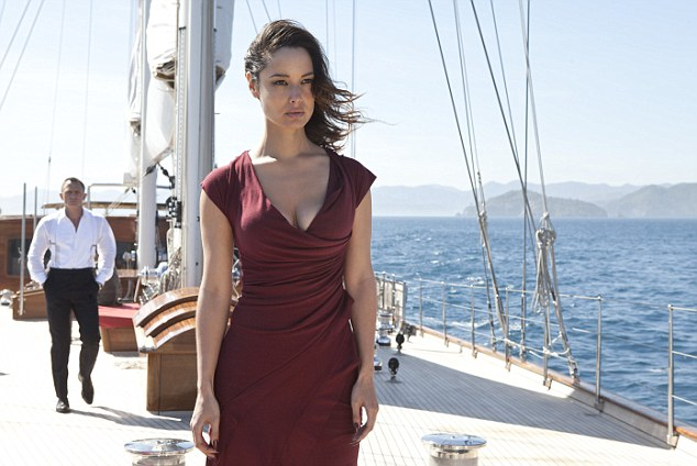 Skyfall's eyefall: New Bond girl Bernice Marlohe with Daniel Craig's 007 in the background