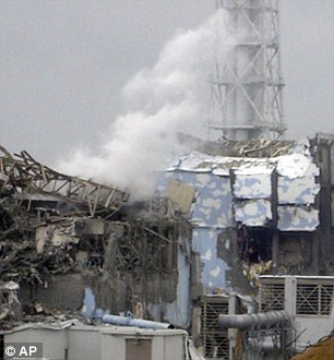 Disaster: Smoke rises from the badly damaged Unit 3 reactor following the explosion at the Fukushima nuclear power plant in March 2011