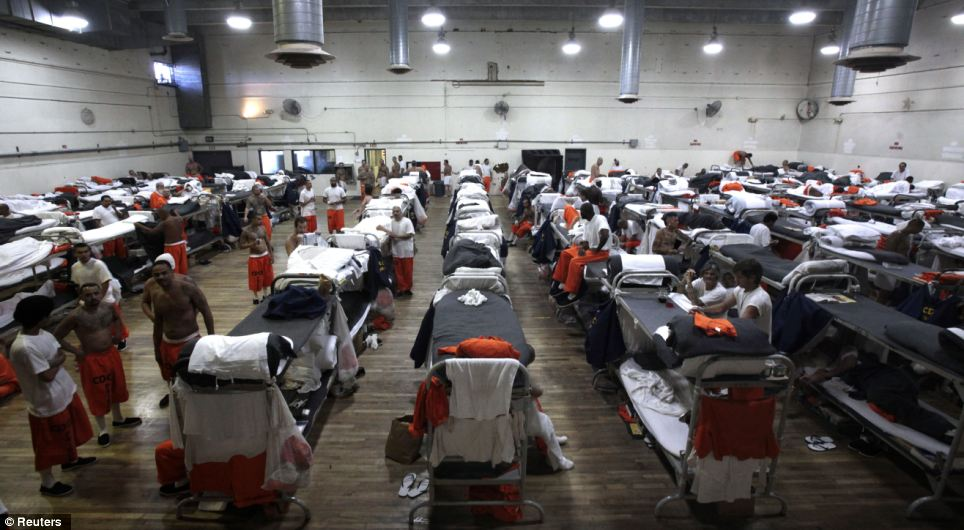 Inmates are housed in a gymnasium at the California Institution for Men state prison in Chino, California. The Supreme Court has ordered California to release more than 30,000 inmates over the next two years