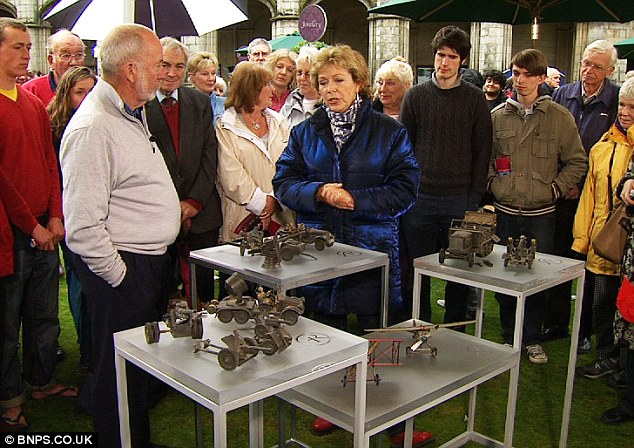 Jerry Beaulier, left wearing a white top, with expert Hilary Kay, right wearing a blue jacket, with his set of army toys on the Antique's Roadshow
