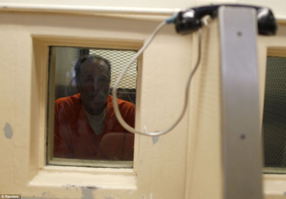 An inmate waits for a visitor at the California Institution for Men state prison in Chino