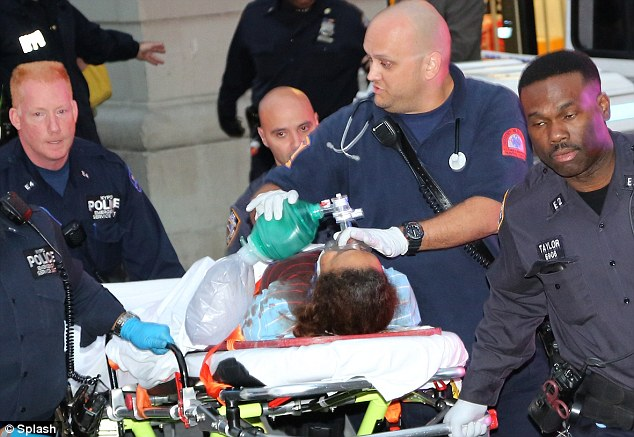 Found: the nany, Yoselyn Ortega, is taken out on a stretcher covered in blood. She is in critical condition