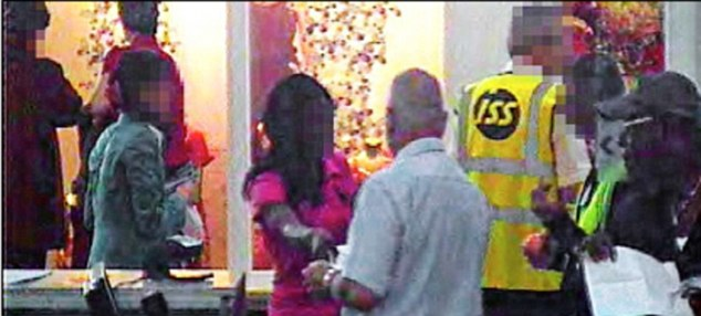 Caught on film: Osezua Osolase (in baseball cap) with young trafficking victims under surveillance at Stansted Airport. The children's faces have been obscured in order to protect their identities