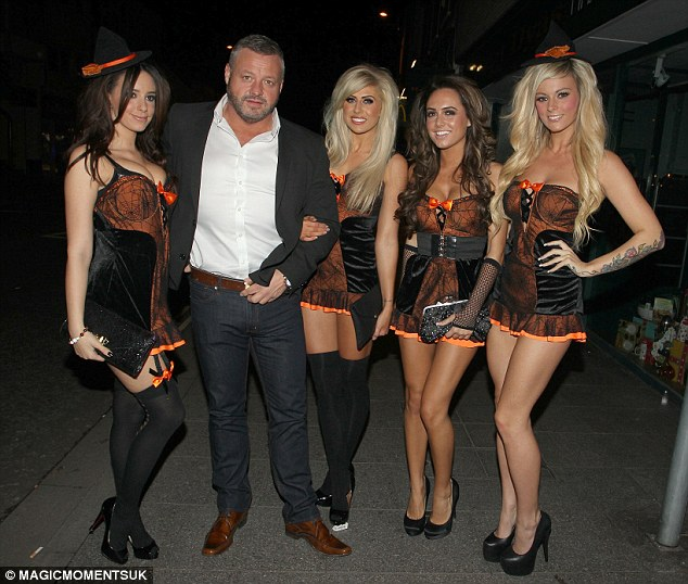 Host: TOWIE's Mick Norcross owns the popular venue and posed outside with some scantily clad females wearing Halloween costume