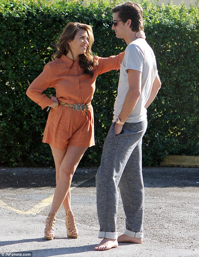 Looking good: Kourtney looked stunning in a pumpkin-coloured romper, which displayed her enviable curves