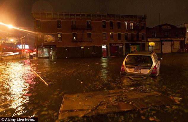 Devastation: The storm's damage is projected at £12 billion