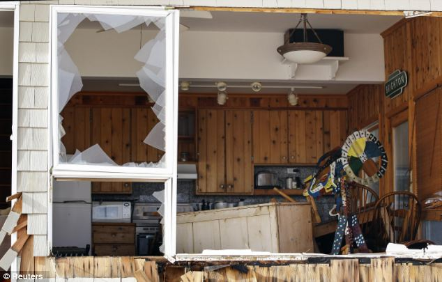 Wreckage: The damage wreaked on a house on the one-mile island, where 120 residents refused to evacuate