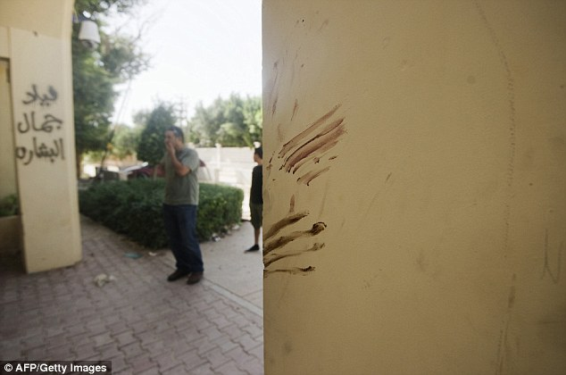 Tragedy: Walls at the main entrance of the US consulate in Benghazi, apparently stained with blood