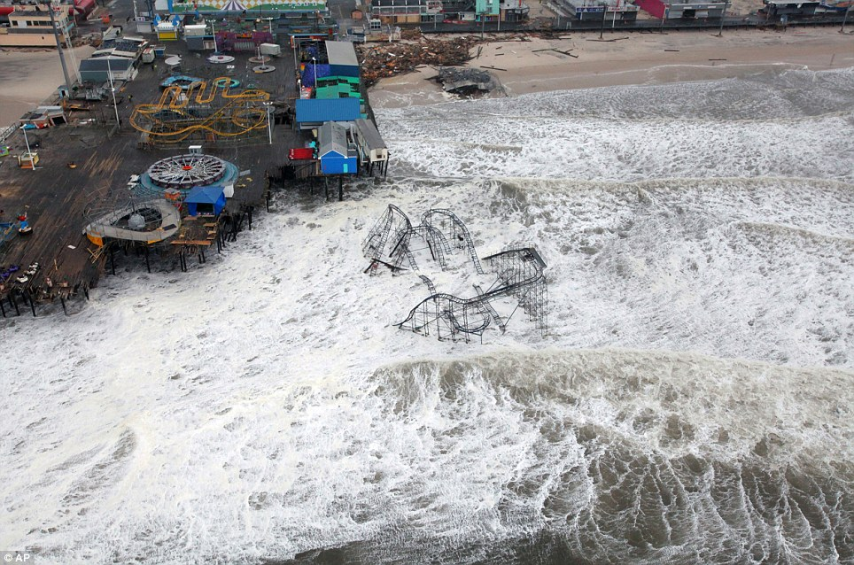 No play: This US Air Force photo shows an aerial view of the rollercoaster from the Seaside Heights amusement park on the New Jersey shore submerged in surf