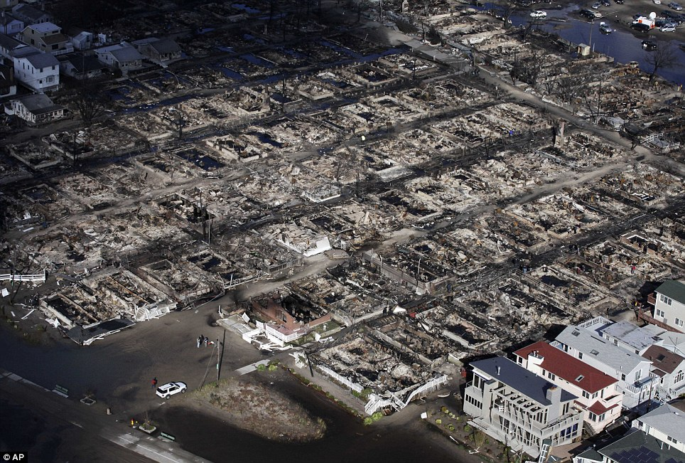 Destroyed: An aerial view of the Breezy Point neighbourhood in New York, where more than 50 homes were burned to the ground as a result of Superstorm Sandy