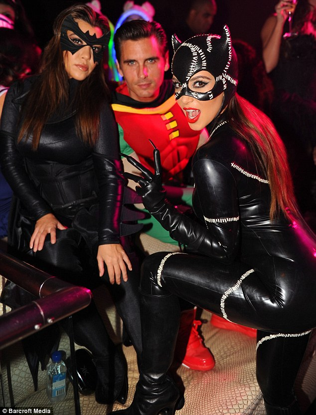 Getting in on the act: Kourtney came as Batgirl while boyfriend Scott Disick dressed up as Robin